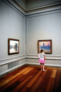 child in front of a monet